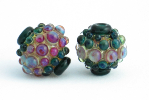 hollow bead with pink / green bumps